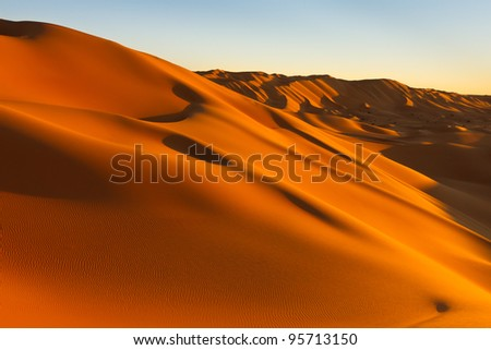 Magic light at sunset at the sand dunes in the Sahara Desert, Libya - stock photo