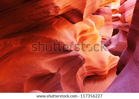 Magic play the red and orange colors in the famous Antelope Canyon in the Navajo Indian Reservation. U.S. - stock photo