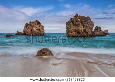 Magic seascape leaky waves. Albufeira, Portugal. - stock photo