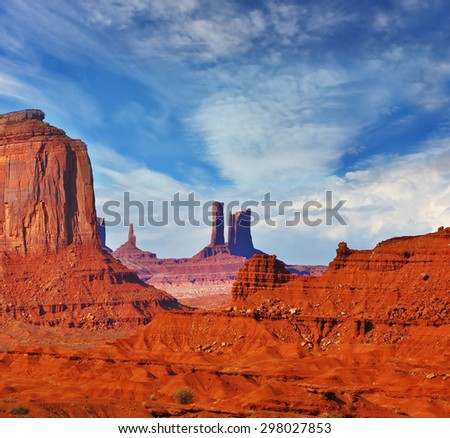 """Magic view of the red desert. The unique red sandstone buttes """"mitts"""". Monument Valley in the Navajo Indian Reservation. Arizona, USA - stock photo"""