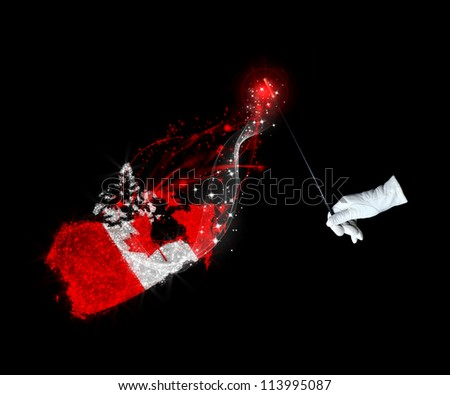 Magic wand and the Canadian flag on a black background - stock photo