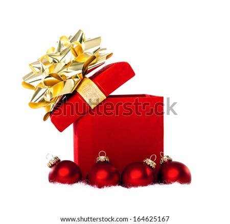 Magical Christmas Gift With Red Baubles Isolated on White - stock photo