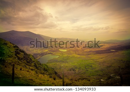 Magical Ireland landscape with hills - stock photo