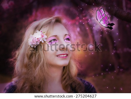 Magical young woman with butterfly. - stock photo
