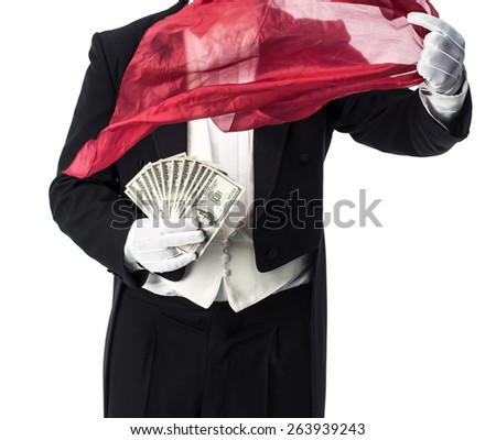 Magician doing an appearance and vanish trick with money - stock photo