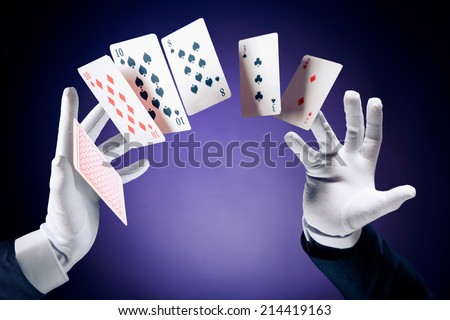 Magician hands with magic cards - stock photo