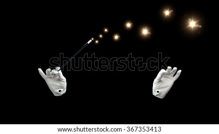 magician hands with magic wand showing trick - stock photo