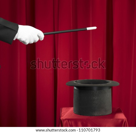 Magician Holding Magic Wand and Top Hat - stock photo