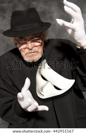 Magician in top hat showing trick. Magic, performance, circus, show concept - stock photo