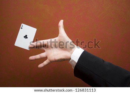 Magician make performance with card - stock photo