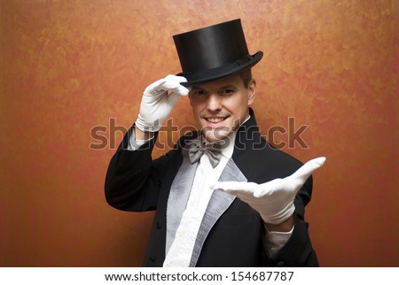 Magician performing a magic trick - stock photo