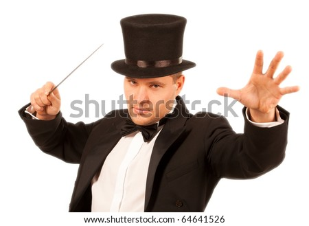 Magician performing a magic trick with magic wand over white background - stock photo