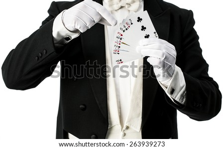 Magician performing trick with cards - stock photo