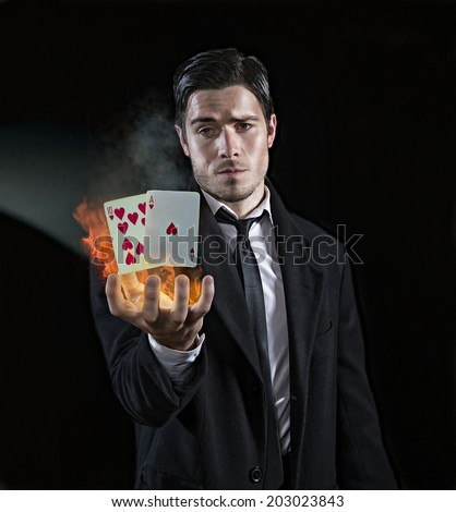 Magician producing black jack - stock photo