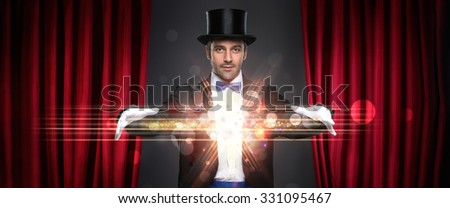 magician showing trick on stage, magic, performance, circus, show concept - stock photo