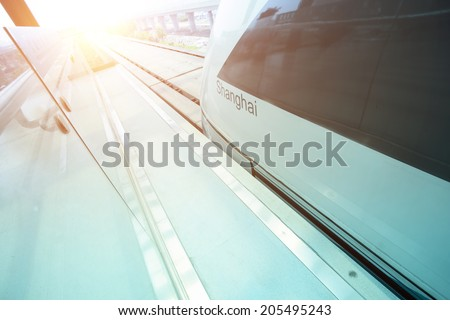 Maglev train arriving shanghai station,china - stock photo