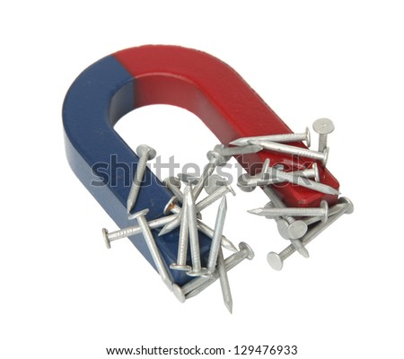 Magnet and nails isolated on a white background. - stock photo