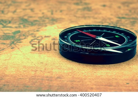Magnetic Compass On The Old Map Background, Closeup, Front View Horizontal Image - stock photo
