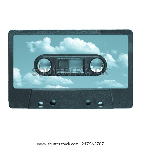 Magnetic tape cassette for audio music recording - blue sky with clouds label - cool cyanotype - stock photo