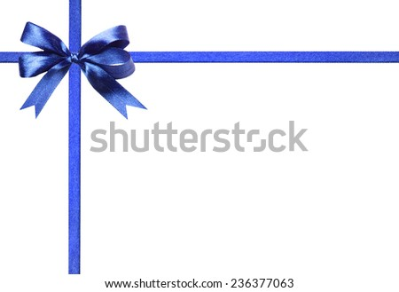 Magnificent blue fabric ribbon and bow. Isolated on a white background - stock photo