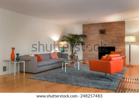 Magnificent living room interior at twilight with view hardwood floor. Couch with hand-woven natural colored fine sisal rug open space living room within nature. - stock photo