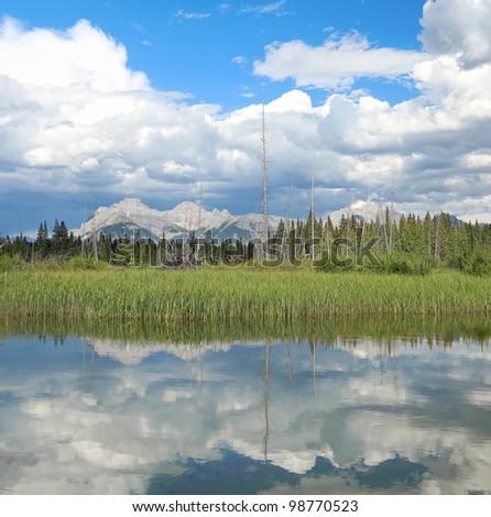 Magnificent mountain lake's reflection. Vermilion Lakes. Banff National Park. Alberta, Canada - stock photo