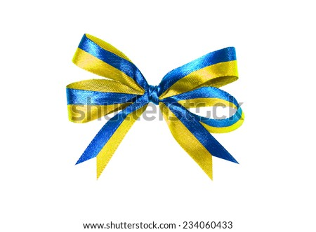 Magnificent multicolor blue-yellow fabric ribbon and bow. Isolated on a white background - stock photo