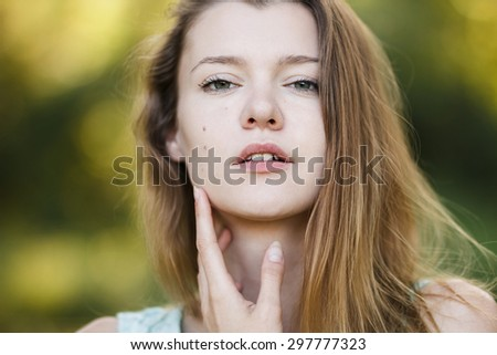 magnificent portrait of a beautiful fashion girl close-up - stock photo