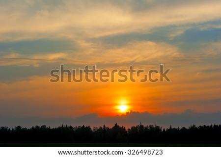 magnificent setting sun in orange tones - stock photo