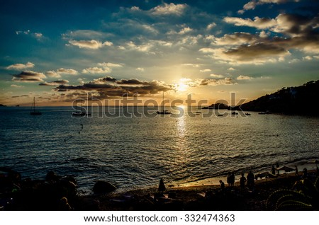 Magnificent sunset above the Mediterranean Sea and sailboats silhouette. Cala d'Hort Beach, Ibiza. Spain  - stock photo
