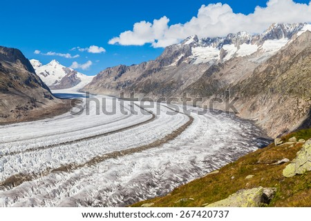 Magnificent view of the Aletsch glacier and the alps on the hiking path alone the glacier, Jungfrau region, Switzerland - stock photo