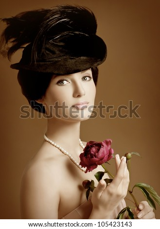 magnificent woman in a hat with feathers - stock photo