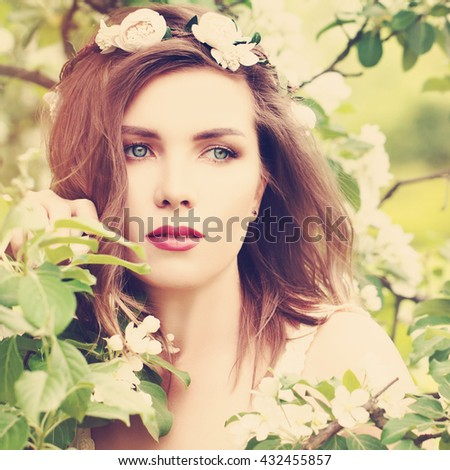 Magnificent Woman with Spring Blossom Background. Girl Outdoors - stock photo