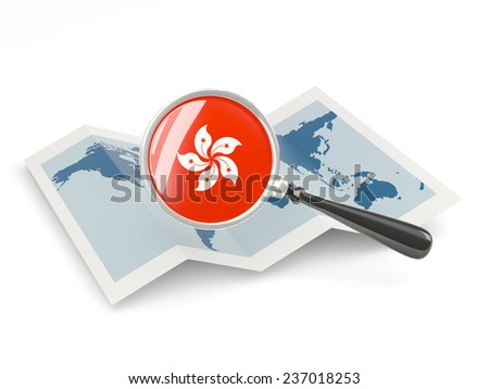 Magnified flag of hong kong with map isolated on white - stock photo
