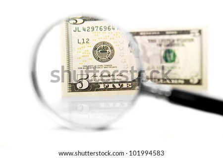 Magnifier and money. On a white background. - stock photo