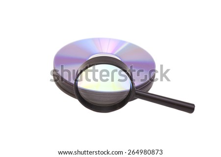 Magnifier glass and DVD isolated - stock photo