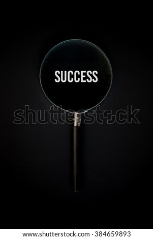 magnifier glass with success text - stock photo