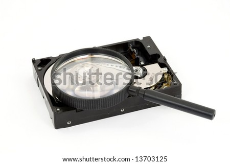 magnifier searching hard disk drive isolated - stock photo