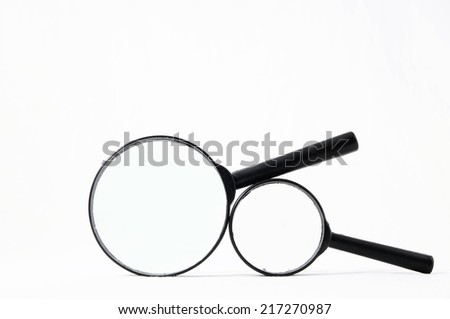 Magnify Glass Loupe Isolated on a White Background - stock photo