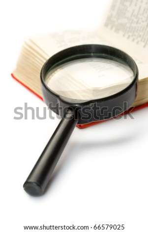 Magnifying glass and book isolated on white - stock photo