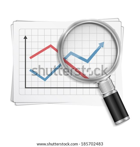 Magnifying glass and charts on the paper - stock photo