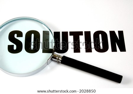 "Magnifying glass and text ""solution"", conceptual. - stock photo"