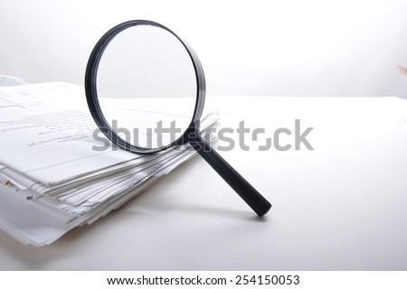 Magnifying glass. Architectural blueprints. Search - stock photo