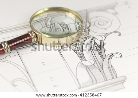 magnifying glass & architectural drawing - detail column - stock photo
