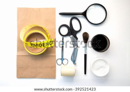 magnifying glass brush  for detection of latent fingerprint  tool in crime scene isolated on white background - stock photo