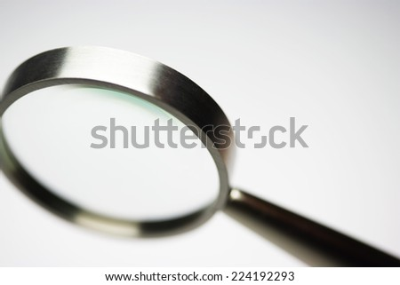 Magnifying glass, close-up - stock photo