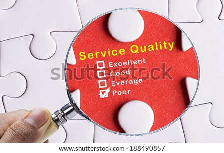 Magnifying glass focusing on Poor evaluation of Service Quality  - stock photo