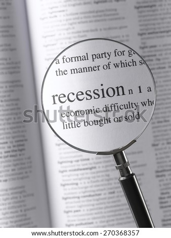 Magnifying Glass Highlighting Recession - stock photo