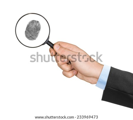 Magnifying glass in hand and fingerprint isolated on white background - stock photo