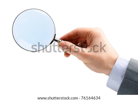 Magnifying glass in hand isolated over white background - stock photo